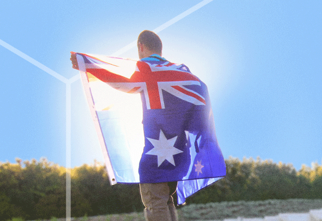 Man with Australian flag draped over shoulders.